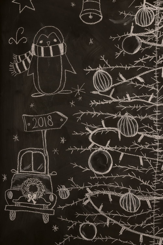 Handlettering kerstdecoratie op krijtmuur